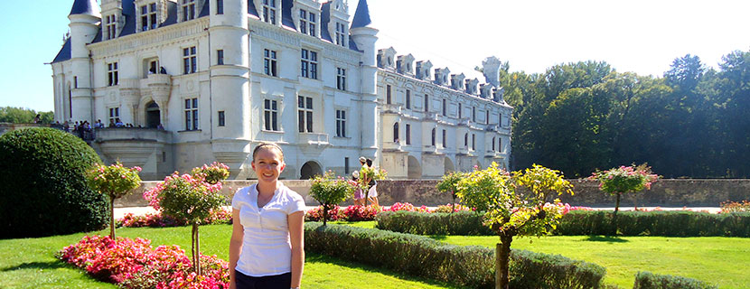student in France posing in front of castle