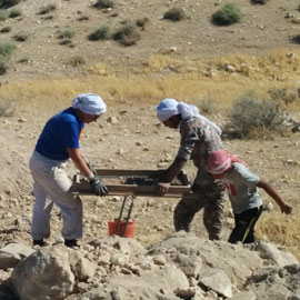 Spotlight story image pertaining to Students doing archaeology in desert
