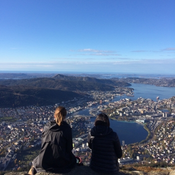 Spotlight story image pertaining to two students looking over a city in norway