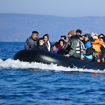 Spotlight story image pertaining to Refugees cross the ocean on a dinghy