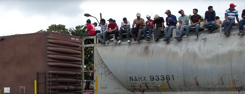 men sitting on top of train