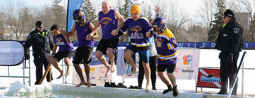 Laurier staff plunging into cold water.