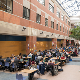 Spotlight story image pertaining to Students studying in the atrium of the science building.