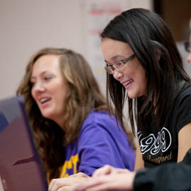 Spotlight story image pertaining to Two female students working on laptops