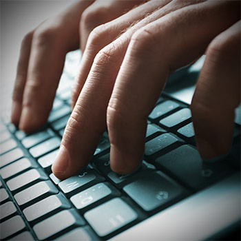 Spotlight story image pertaining to Image of a hand typing on a laptop keyboard