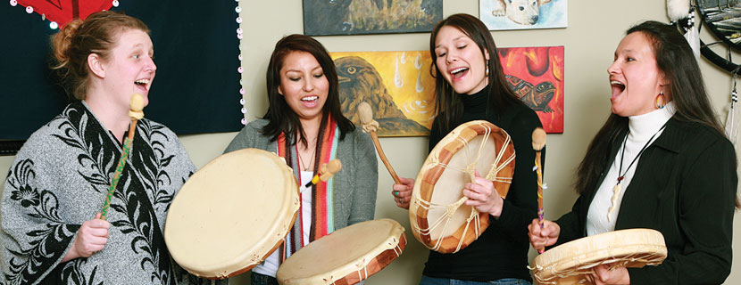 Students singing and drumming