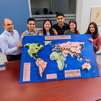 Spotlight story image pertaining to Students with map of the world