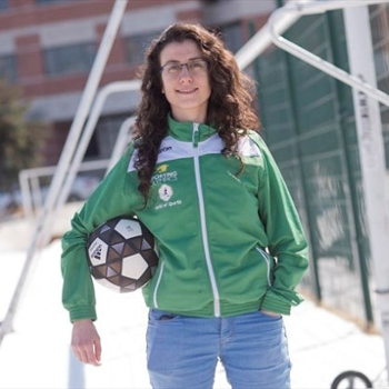 Spotlight story image pertaining to Mary Saleh holding a soccer ball