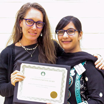Spotlight story image pertaining to Rebekah and Humera with award